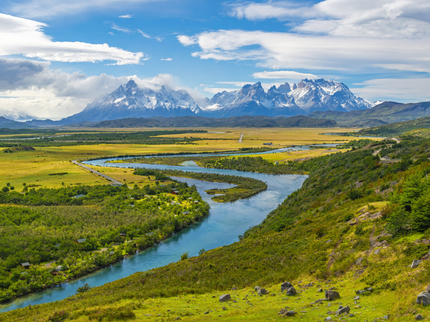 The Andes peaks of Paine Grande, Cuernos del Paine and Torres del Paine on a summer day