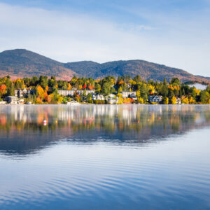 Photo of the Mountain Village of Lake Placid at Sunrise from a Fog Covered Mirror Lake